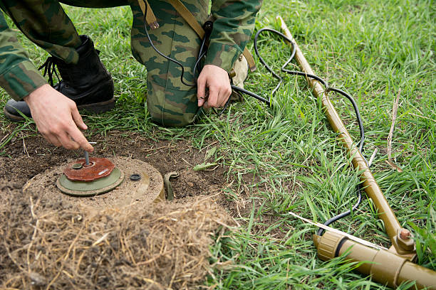 Neutralization of anti-personnel mines soldier stock photo
