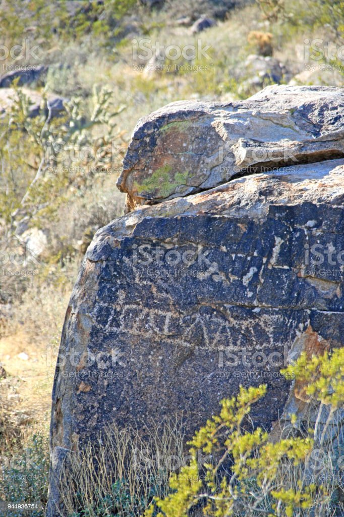 Nevada desert tribal petroglyph on rocks boulders stock photo