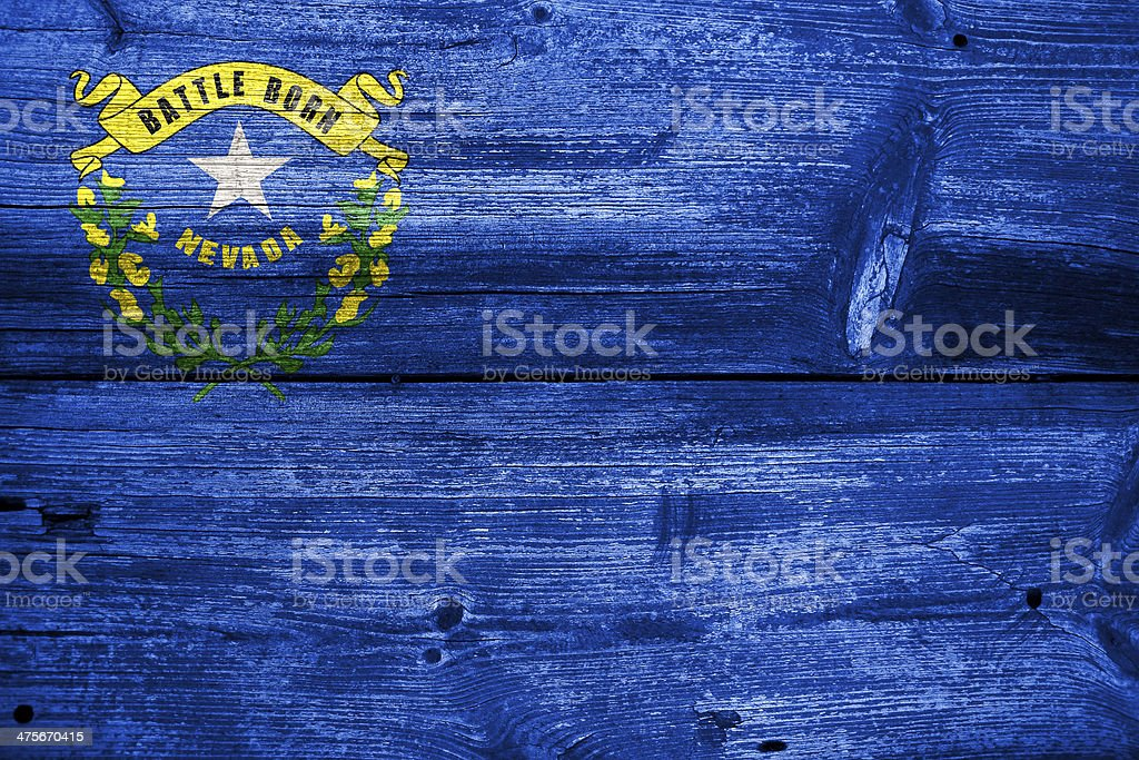 Nevada State Flag painted on old wood plank texture royalty-free stock photo