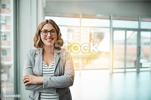 Portrait of a confident young businesswoman standing in an office