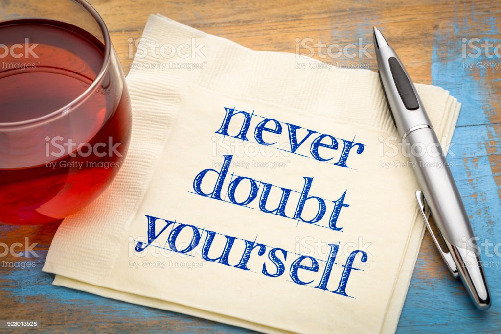 Never doubt yourself text on napkin stock photo
