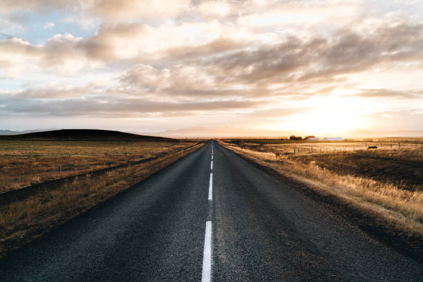 Never ending road till horizon on a sunrise sunset Never ending road till horizon on a sunrise sunset straight stock pictures, royalty-free photos & images