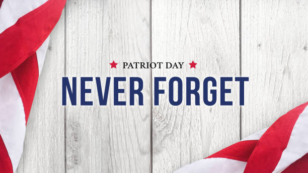 Never Forget - Patriot Day Text Over White Wood stock photo