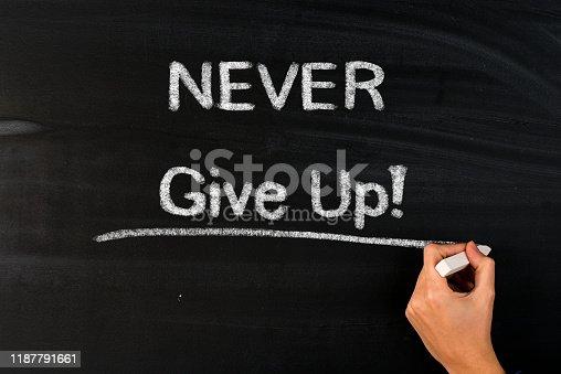 Never give up motivational message on blackboard