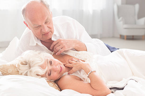 Older Couple Making Love Stock Photos, Pictures & Royalty