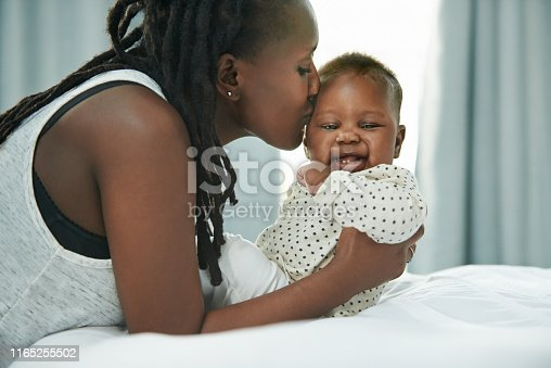 Shot of a mother and her newborn baby at home