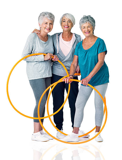 never mind hoopla, we'd rather do the hula - hula hoop workout stock-fotos und bilder