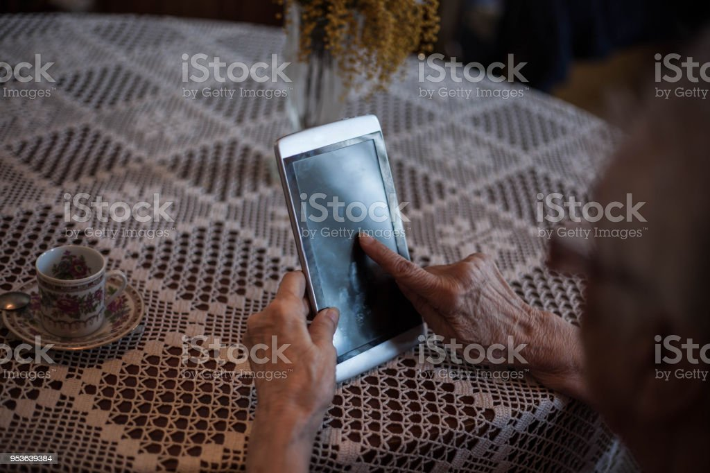 Never old for technology. stock photo