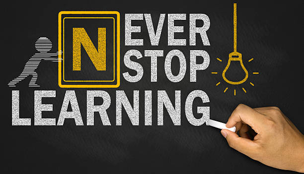 never stop learning concept on blackboard stock photo