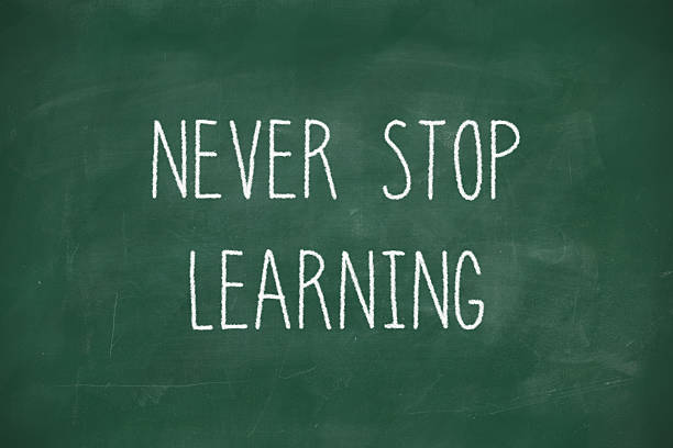 Never stop learning handwritten on blackboard stok fotoğrafı