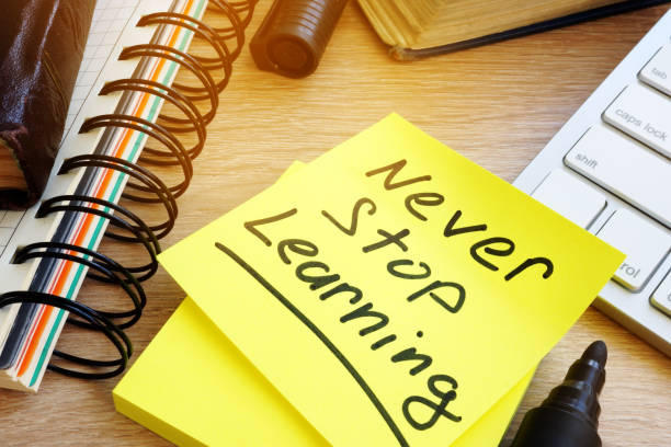 never stop learning written on a stick. lifelong learning concept. - adult education stock pictures, royalty-free photos & images