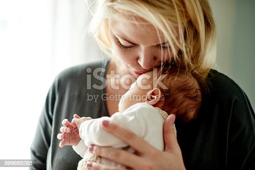Shot of a mother spending time with her newborn baby