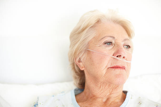 Never thought it would happen to me- Illness Ailing senior woman wearing a nasal cannula looking out of her hospital window thoughtfully - Copyspace oxygen tube stock pictures, royalty-free photos & images