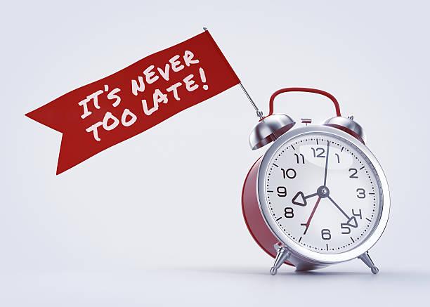 «Never Too Late!» Alarm stock photo