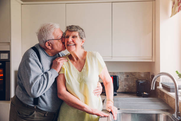 Never too old for a cheeky kiss! stock photo