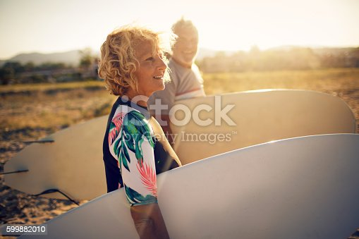 istock Never too old for surfing 599882010