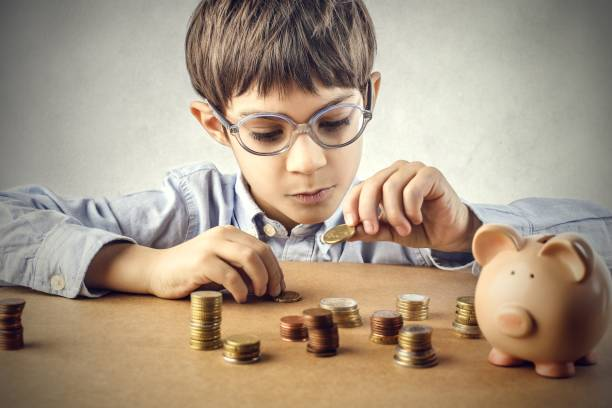 Never too young Little boy playing with coins allowance stock pictures, royalty-free photos & images