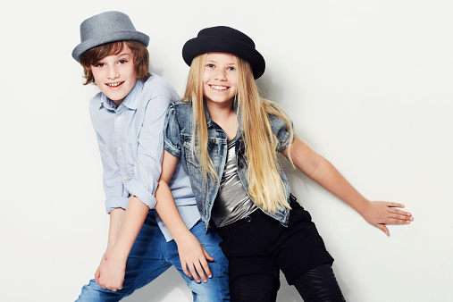 Shot of two playful kids in a studiohttp://195.154.178.81/DATA/istock_collage/0/shoots/782273.jpg