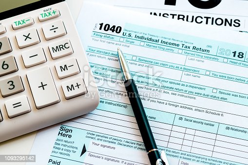 Istock New 2019 Irs 1040 Tax Form Instructions Pen And Calculator