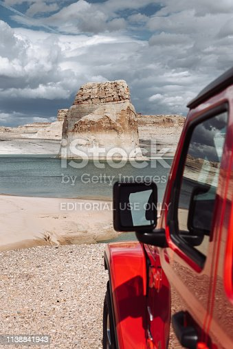 Lone Rock Beach, Utah, United States - March 7, 2019: Photo of a Jeep Wrangler Sahara 2019 edition parked in front of the beach of the Lone Rock Beach close to the Lake Powell ,Utah, USA. It is the new wild offroad vehicle by Jeep.