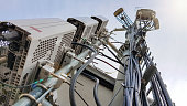 istock New 5G radio network telecommunication equipment with radio modules and smart antennas mounted on a metal tower 1149326502