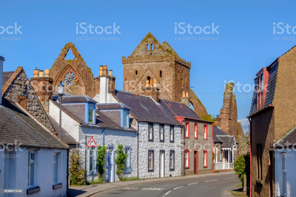 New Abbey, the village which stands next to the ruins of the Sweetheart Abbey (in background) - Scotland