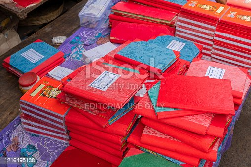 Kolkata, West Bengal, India - 15th April 2019 : New accounts books are being stacked up for sale. Traditionally, brand new books are used starting from Bengali new year, called nabobarsho in Bengali.
