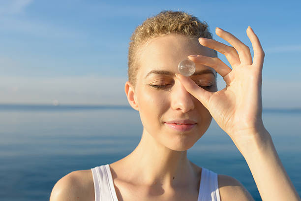 New Age Wellness Portrait with Quartz Crystal Sphere stock photo