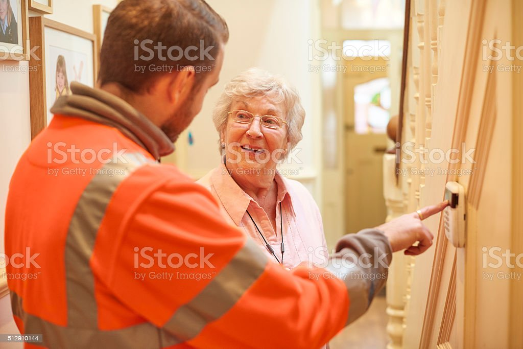 new alarm for senior woman stock photo