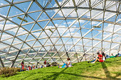 Moscow - June 17, 2018: People relax in a new amphitheater with glass roof in Zaryadye Park in Moscow center in summer, Russia. Modern Zaryadye is one of the main tourist attractions of Moscow.