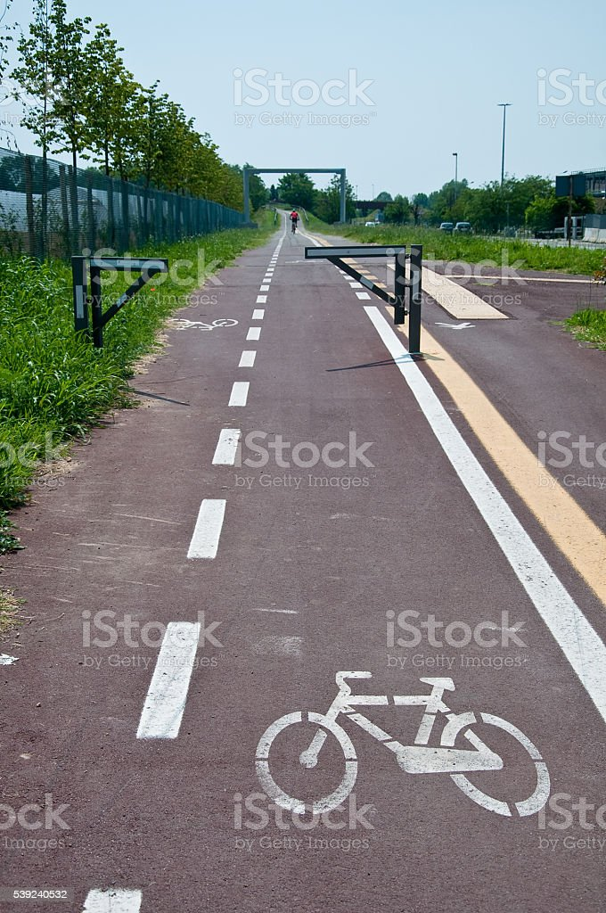 new and long bike path drawn on the ground royalty-free stock photo