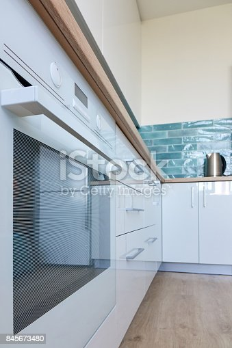 607472174 istock photo New and modern kitchen in bright colors 845673480