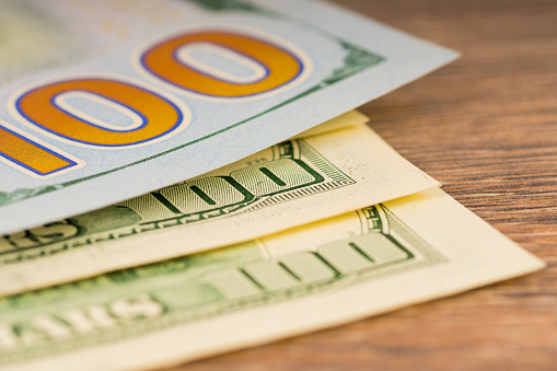 693363558 istock photo new and old 100 dollars, background with paper money 1044240422