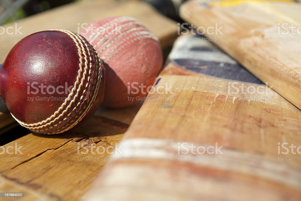 New and old cricket ball lying on bats royalty-free stock photo