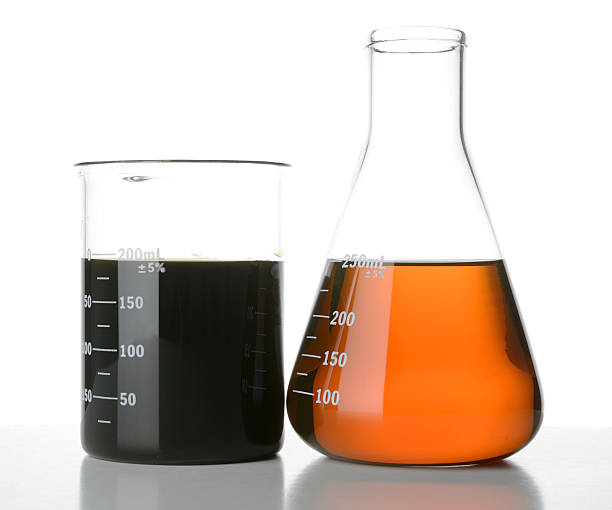 New and Used Motor Oil in Laboratory Glassware stock photo