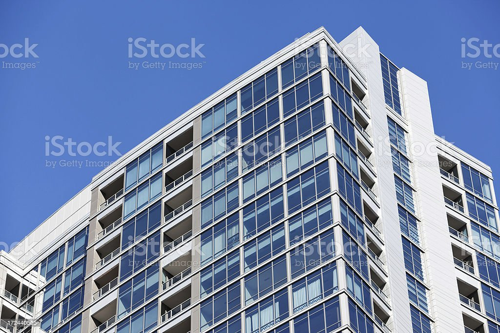 New Apartment Building Exterior against Blue Sky royalty-free stock photo