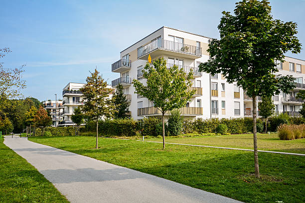 New apartment building - modern residential development New apartment building - modern residential development in a green urban settlement gated community stock pictures, royalty-free photos & images