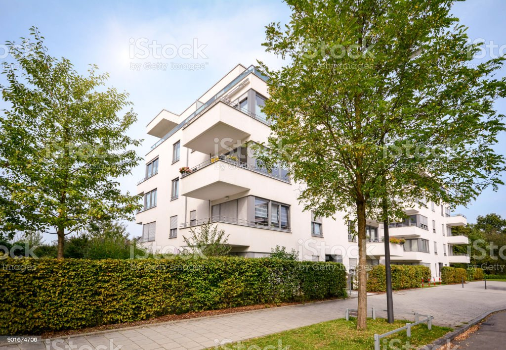 New apartment building, modern residential development with outdoor facilities in a green urban settlement stock photo