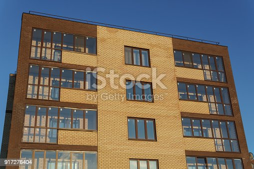 istock New apartment building with balconies against the blue sky 917276404
