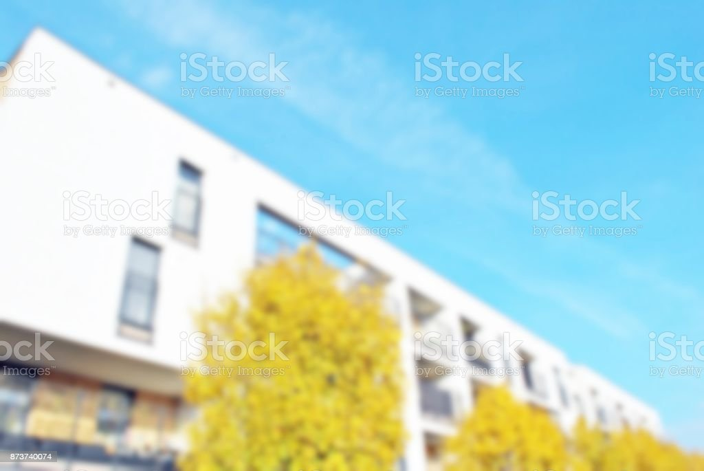 New apartment buildings blurred background stock photo