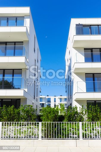 889473004 istock photo New apartment buildings with a modern white facade 930100058