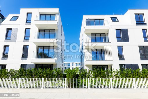 889473004 istock photo New apartment buildings with a modern white facade 930124948