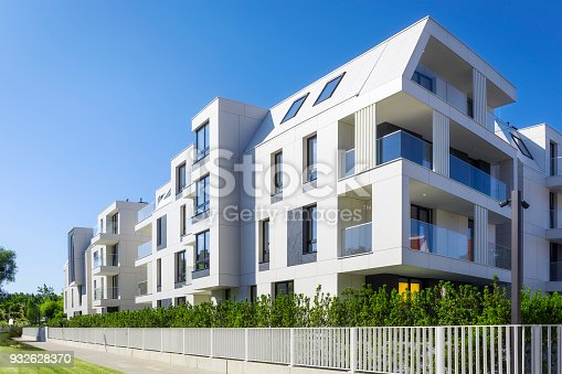 889473004 istock photo New apartment buildings with a modern white facade 932628370