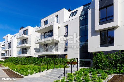 889473004 istock photo New apartment buildings with a modern white facade 932692742