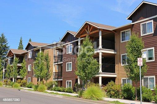 108220043 istock photo New apartment complex in suburban neighborhood 485857090