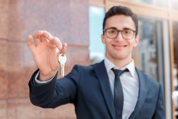 New apartment real estate agent in eyeglasses standing on the city picture id1165006440?b=1&k=6&m=1165006440&s=612x612&w=0&h=f3xuqxzvaxkddhzoryvmsmhvapwhbl2ts 3awsafnzu=