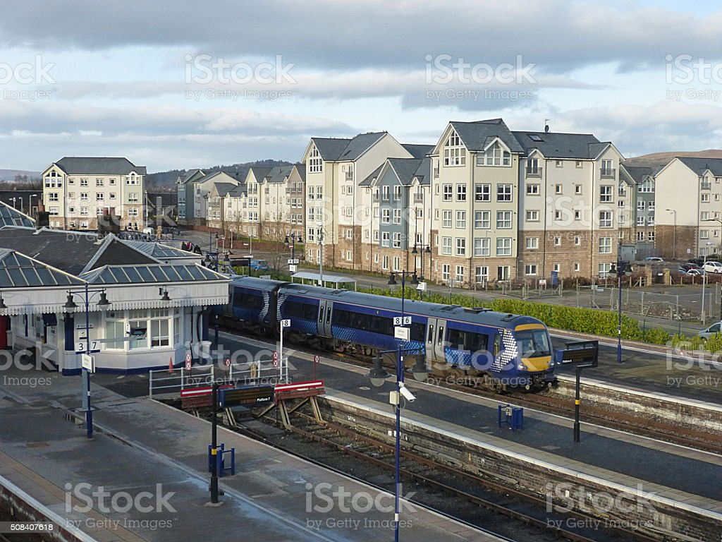 New apartments alongside railway station stock photo