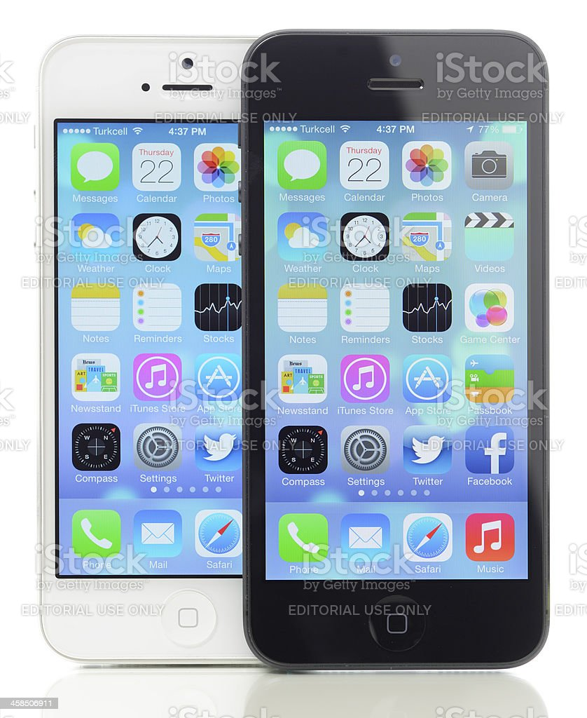 New Apple iOS 7 operating system on two iPhone 5 royalty-free stock photo