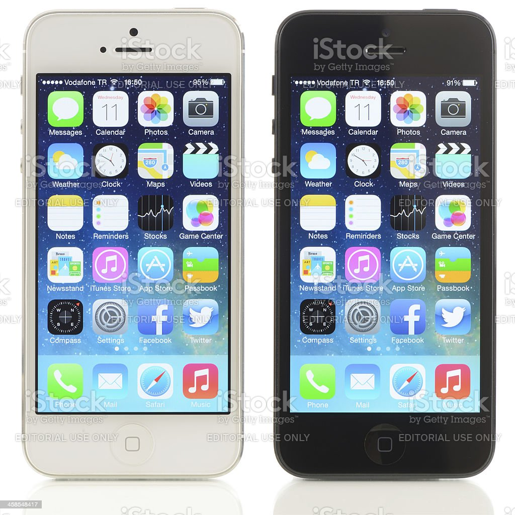 New Apple iOS 7 screenshot on two iPhone 5 royalty-free stock photo