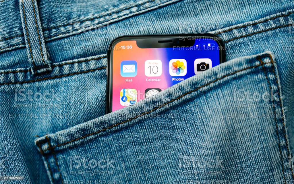 New Apple iPhone X 10 in pocket of denim jeans trousers stock photo